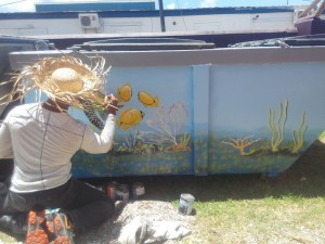 Nevisian artist Vaughn Anslyn working on his masterpiece